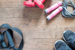Flat lay of red dumbbells and sport equipment on wood background. Flat lay of cellphone, red dumbbells and sport equipment on wood background. Sport wear, Sport Royalty Free Stock Photos
