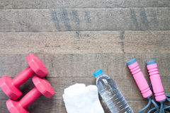 Flat lay of red dumbbells and sport equipment on wood background. Flat lay of cellphone, red dumbbells and sport equipment on wood background. Sport wear, Sport Stock Photo