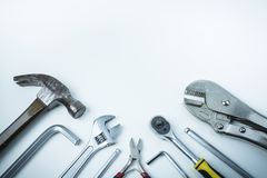 Flat lay of repairman equipments and tools, white background, co Stock Photos