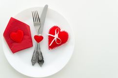 Flat lay romantic dinner proposal concept. Dish with cutlery and heard shape box stock photography