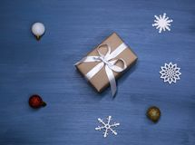 Flat lay of romantic gift wrapped and decorated with bow on blue background with copy space royalty free stock photo