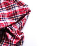 Flat lay of scarf with Christmas tartan texture on white background. Flat lay of scarf with Christmas tartan texture on white background stock photos