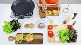 Flat lay scene video of time lapse of someone cooking hamburger stock footage