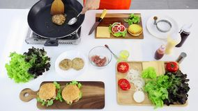 Flat lay scene video of time lapse of someone cooking hamburger. Flat lay scene video of time lapse of someone cooking hamburger in kitchen stock video footage
