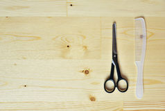 Flat lay of scissors and comb Stock Photo
