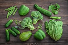 Flat lay series of assorted green toned vegetables royalty free stock images