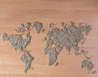 Flat lay set with cereals in the form of the continents or map of the world. Installation of a map of the world with buckwheat groats stock image