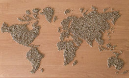 Flat lay set with cereals in the form of the continents or map of the world. Installation of a map of the world with buckwheat groats stock photo