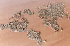 Flat lay set with cereals in the form of the continents or map of the world. Installation of a map of the world with buckwheat groats stock photos