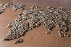 Flat lay set with cereals in the form of the continents or map of the world. Installation of a map of the world with buckwheat groats royalty free stock image