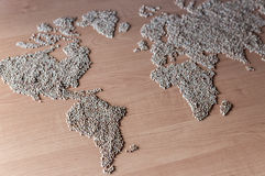 Flat lay set with cereals in the form of the continents or map of the world. Installation of a map of the world with buckwheat groats royalty free stock photography