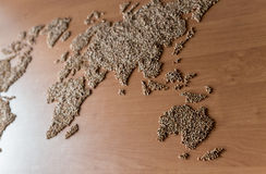 Flat lay set with cereals in the form of the continents or map of the world. Installation of a map of the world with buckwheat groats royalty free stock images