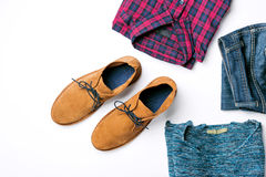 Flat lay set of clothing for men on white background. Top view Royalty Free Stock Photography