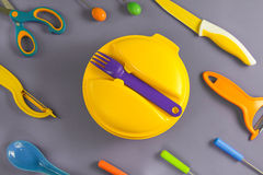 Flat lay set of colour plastic ware Royalty Free Stock Images