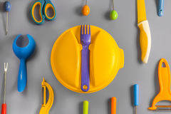 Flat lay set of colour plastic ware Stock Photography