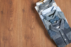 Flat lay set denim  shirts for small boys with free space Royalty Free Stock Image