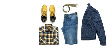 Flat lay set Men`s casual clothing, jacket blue jeans checkered shirt yellow nubuck shoes strap isolated items on white backgroun. D top view. Male fashion stock images
