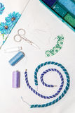Flat Lay. Set for needlework. Blue and turquoise beads on a white background. Royalty Free Stock Photo