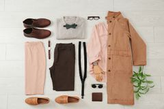 Flat lay set of stylish clothes and accessories. On wooden floor Stock Photo