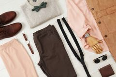 Flat lay set of stylish clothes and accessories. On wooden floor Stock Photography