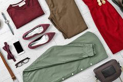 Flat lay set of stylish clothes and accessories. On wooden floor Stock Image