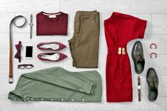 Flat lay set of stylish clothes and accessories. On wooden floor Royalty Free Stock Images
