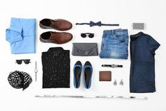 Flat lay set of stylish clothes and accessories. On white background Royalty Free Stock Photos