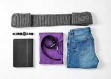 Flat lay set of stylish male clothes and accessories. On white background Stock Photos