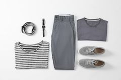 Flat lay set of stylish male clothes and accessories. On white background Stock Photography