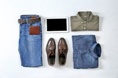 Flat lay set of stylish male clothes and tablet  on white background. Flat lay set of stylish male clothes and tablet on white background Royalty Free Stock Photos