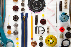 Flat lay of sewing tool and accessories on white wooden backgrou Royalty Free Stock Photos