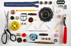 Flat lay of sewing tool and accessories on white wooden backgrou Royalty Free Stock Photography