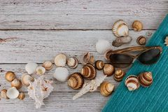 Flat lay with shells, beach accessories and glasses. stock photo