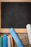 Flat lay, slate with colorful crayon Royalty Free Stock Images