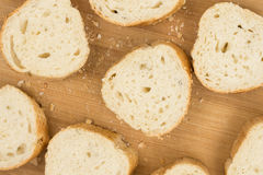 Flat lay sliced bread on the wooden cutting board Stock Photos