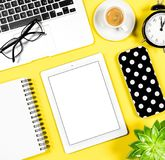 Flat lay social media notebook coffee yellow background. Flat lay social media. Notebook, tablet PC, coffee on yellow background Stock Photo