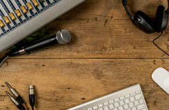 Flat lay of sound equipments. Mixer, Microphone, jack with cable, Headphone and computer keyboard with white mouse Royalty Free Stock Image