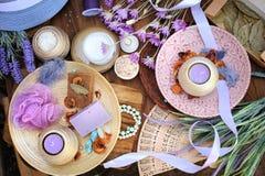 Flat lay spa accessories, handmade artisan soap, fresh flowers, wisp of bast, candles, bath salt Royalty Free Stock Photo