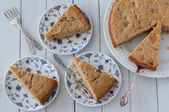Flat Lay Spiced Apple Cake from Above. Served on Plates on White Wooden Background Stock Photo