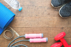 Flat lay of sport equipments on wood background Stock Images
