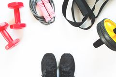 Flat lay of sport and fitness equipment on white background. Sport accessories, top view Royalty Free Stock Photography