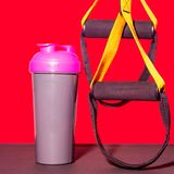 Flat lay sport shoes, bottle of water, dumbbells and earphones on gray concrete background. Concept healthy lifestyle, sport and d stock images