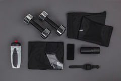 Flat lay with sportswear, fitness equipment and gadgets Royalty Free Stock Photography