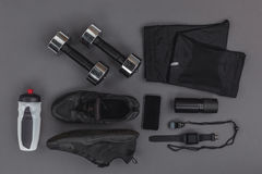 Flat lay with sportswear, fitness equipment and gadgets Stock Photos
