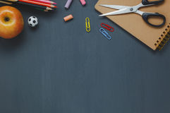 Flat lay stationery education / back to school on black table wood. Royalty Free Stock Images