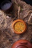 Flat lay still life with potty with pollen.  royalty free stock images