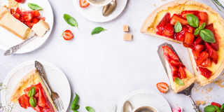 Flat lay with strawberry cheesecake Stock Photos