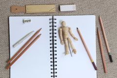 Flat lay style art and sketching concept. A flat lay style concept of art and sketching, with a variety of pencils and other art supplies, an open sketch book stock illustration