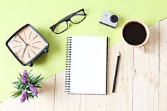 Flat lay style of office workspace desk with blank notebook paper, cup of coffee and accessories. Business concept : Flat lay style of office workspace desk with royalty free stock photos