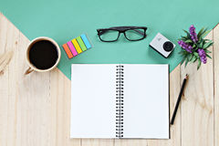 Flat lay style of office workspace desk with blank notebook paper, cup of coffee and accessories. Business concept : Flat lay style of office workspace desk with stock images